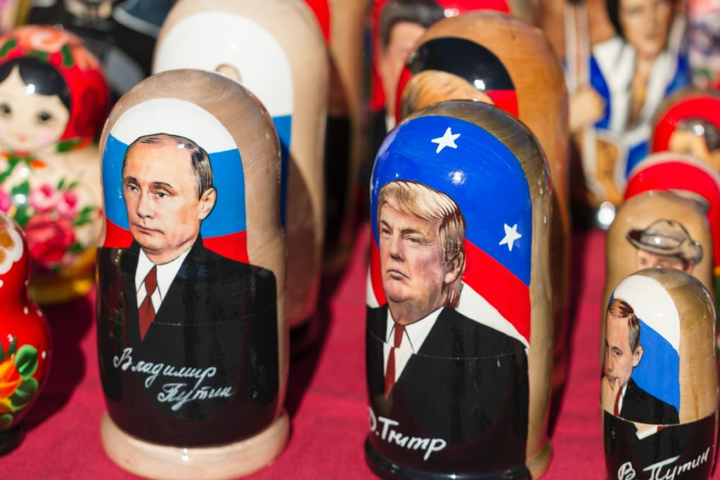 Donald Trump nesting dolls on red textile
